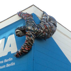 Sloth sculpture constructed from bicycle fenders